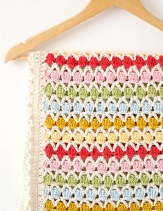 Crochet your own Beatrice Blanket! A wonderful easy to make blanket that is suitable for beginners. The blanket is great to make as a baby blanket or a adult afghan or even for a bed. Its beautifully bright and great for stash busting. >> What You Get << You will receive by email a