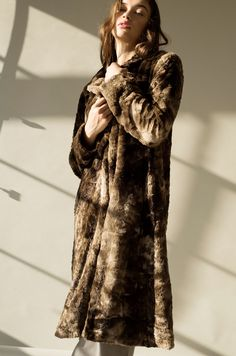 Our iconic coat, inspired by that perfect 1920's fur.Teddy is warm + cozy with a slim, relaxed fit. Cool enough for everyday, yet refined enough for an elegant evening out.