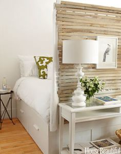 Use wooden slats as a beachy accent for an all-white room. Find over 100 design ideas for sprucing up your bedroom on BAZAAR:
