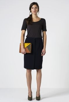 Mara is a straight fit pencil skirt with a panel of hidden buttons at the front. It is fitted at the waist and drops straight to the knee....Rodebjer