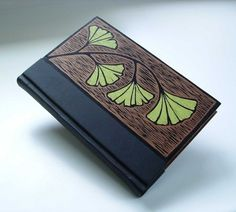 Hand-made book bound in leather, wood, original block-print cover art.