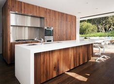 Waterfall benchtop, panelled cabinets | Honiton Residence | MCK Architects.