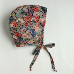 Primary floral Liberty of London baby bonnet by RainPeopleBC