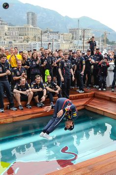 Red Bull's F1 Formula One driver Mark Webber of Australia celebrates his victory at a pool after the finish of the Monaco F1 Grand Prix.