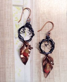 """Feb ABS """"Forest Berries"""" by Sarah Raines. Hand forged and patinated copper leaves, clay berries, and wire wreaths.  Inspiration from Heather Powers new book of techniques."""