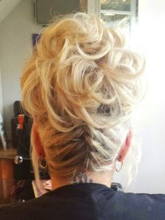 Braids are very on trend at the moment. Why not pop one into the back of your up do on a special occasion? - as we did here.