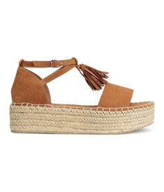a32dd01b70 Camel. Platform sandals with braided jute trim around soles. Decorative  tassels at front and