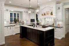 Traditional Kitchen by Oakley Home Builders - Like island is a different color, such as this black, in an otherwise white kitchen. Classic Kitchen, New Kitchen, Kitchen Decor, Kitchen Ideas, Rustic Kitchen, Kitchen Photos, Kitchen Layout, Kitchen Black, Eclectic Kitchen