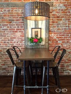 repurposed table from old flooring and plumbing pipe-rough luxe: Farmers Union Pour House is Up and Running