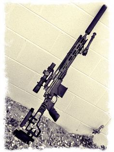 300 Blackout chambered Remington 700 RACS with an AAC Titan can.
