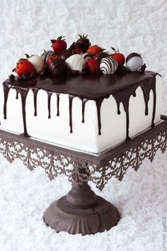 A luscious white and chocolate layered cake with my finest whipped white chocolate frosting, dark chocolate ganache and decadent chocolate covered strawberries and curls. I lovethis 4-layered vanilla-chocolate cake!  URBAN BAKES