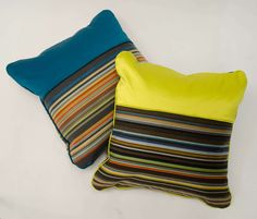 """Two feather infill cushions, upholstered in Maharam Paul Smith striped fabric, combined with Casamance """"sateen"""" fabric and piping.  https://www.1stdibs.com/furniture/seating/sofas/cushion-paul-smith-fabric/id-f_1256256/  https://www.1stdibs.com/furniture/more-furniture-collectibles/pillows-throws/cushion-paul-smith-fabric/id-f_1256254/"""