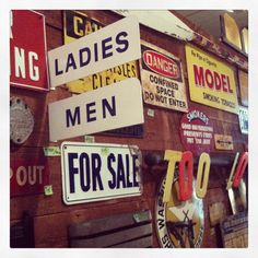 An entire wall of vintage signs