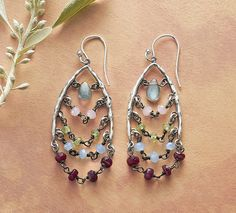 Rainbow Wishes Earrings - Hand-forged sterling silver wishbones are strung with tiers of cascading color—peridot, ruby, labradorite and pink and blue chalcedony.