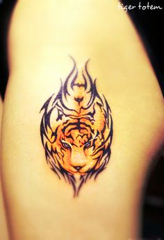 a face of tiger tattoo surrounded by totem on hip Body Art Tattoos, Girl Tattoos, I Tattoo, Tattoos For Women, Tatoos, Detroit Tattoo, Totem Tattoo, Tiger Tattoo Design, Free Tattoo Designs