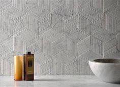 Romboo is a stone texture composed of a series of rhombus-shaped tiles made from offcuts of natural stone which form a three-dimensional hexagonal effect. Marble Stones, Stone Tiles, Wall Patterns, Textures Patterns, Best Cleaning Products, Tiles Texture, Wall Finishes, Landscape Walls, Tile Design