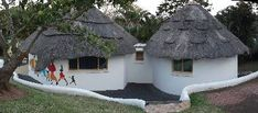 The two rondavels from a different perspective Thatched House, Thatched Roof, African Hut, Round House Plans, African Interior Design, Mud Hut, Hut House, Cottage In The Woods, Natural Building