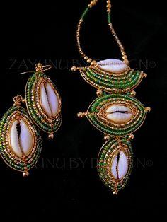 Green Gold Cowry shield set by zayday on DeviantArt Seashell Jewelry, Wire Jewelry, Boho Jewelry, Fashion Jewelry, Jewelry Design, Jewellery, Shell Earrings, Shell Necklaces, Beaded Earrings