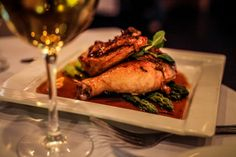 Braised Free Range Chicken with caramelized shallots, rosemary, pan jus & asparagus #chicken #finedining #whitewine #steakhouse #rothmanns