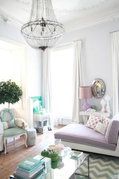 Perfect balance of mint and orchid and patterns in a living room.