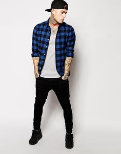 Blue check shirt, grey ribbed vest, black skinny jeans, black Nike Air Max
