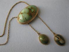A Victorian solid gold and turquoise pendant necklace that is from the 1910's.