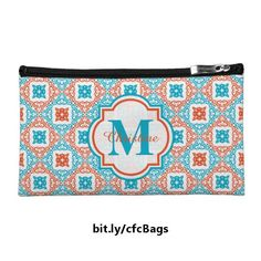 This fancy zippered bag features a repeating design of diamonds in coral and teal, each edged with a swirly graphic and containing a colored flower in the center. The design on each side is topped with a semi-transparent white tag containing a customizable name and initial. https://www.zazzle.com/z/347ak&tc=20170215_pint_SSOZ #accessories #monogram #StudioDalio #Zazzle