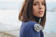Hand knitted wool poncho with flower detail by Plexida on Etsy, €42.00