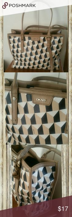 DKNY Donna karan chevron handbag purse bag tote Bundle for discounts!   Has some marks here and there, but hard to notice with the pattern. 13 * 10. Straps about 9 inches high from the top of the bag.   #ashleisgoodies #dkny #bag #purse #satchel #handbag #classy #classic #casual #designer #chevron #tan #black #white DKNY Bags