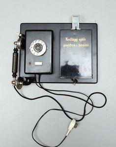 Old swedish wall telephone with coin box. circa 1930.