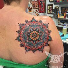 Traditional, tribal, back tattoo on TattooChief.com
