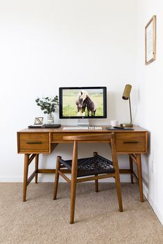 Brass and wood furniture with tapered legs are staples of mid century modern design