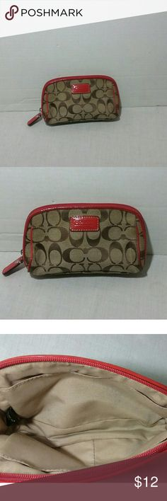 """Coach Small Clutch Pouch Cute preowned small Coach clutch pouch with three interior pockets.   Approx H 3 1/2"""" x L 7"""" x D 1"""".  Preowned.  Interior shows some dark spots and ink stains.  Bottom shows soiled streaks.  No abrasion or rub tear on the exterior.  Thanks for looking! Coach Bags Clutches & Wristlets"""