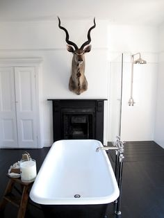 I love this Before and After: A Victorian Bath Transformed : Remodelista Convert one of your neglected rooms into a bathroom spa with a floating tub and an electric fireplace. Gus Modern has a faux Dear head that has the same look House Design, Interior Design, Man Bathroom, Bath Remodel, Victorian Bath, Masculine Bathroom, Home, Bathroom Design, Masculine Interior