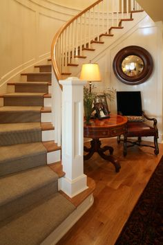 curved double stair entry hall