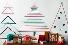 Christmas Decor Ideas - 14 DIY Alternative Modern Christmas Trees | Simple trees made from strips of washi tape are an easy way to create Christmas tree shapes on your walls that can be as simple or as elaborate as you like.