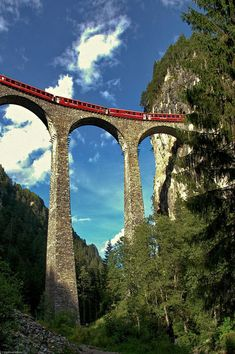 This is the Landwasser Viaduct in Switzerland. A Viaduct is a bridge-like structure that allows cars or trains to travel over valleys or gorges. Places To Travel, Places To See, Places Around The World, Around The Worlds, Trains, Visit Switzerland, Zermatt, Train Tracks, Covered Bridges