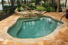 I love natural looking swimming pools