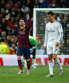Lionel Messi of Barcelona celebrates scoring his team's third goal as Cristiano Ronaldo of Real Madrid looks dejected during the La Liga match between Real Madrid CF and FC Barcelona at the Bernabeu on March 23, 2014 in Madrid, Spain.