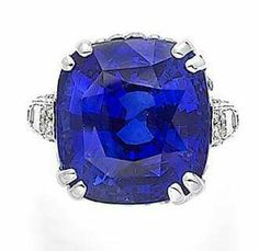 A sapphire and diamond ring,  by Chantecler.  Set with a cushion-cut sapphire, weighing 36.83 carats, to a single-cut diamond-set gallery with pierced foliate detailing, between collet-set baguette-cut diamond-set shoulders, mounted in platinum, the diamonds estimated to weigh approximately 3.00 carats in total,