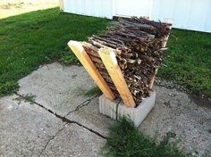 Here's a great way to keep kindling off the ground, easily accessible and neatly stacked through the fall for those cool evenings around the fire with friends and family; Place a 2x4 in a cinderblock (both sides as pictured) and stack kindling tinder neatly.