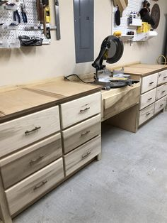 These plans are great for building out your shop This miter station has so many drawers you won t know what to do with all the room Miter saw station garage cabinets cabinet build cabinets with drawers shop station cabinet drawers miter station Workbench Plans, Woodworking Workbench, Woodworking Projects Diy, Garage Workbench, Youtube Woodworking, Woodworking Machinery, Garage Plans, Woodworking Techniques, Diy Projects