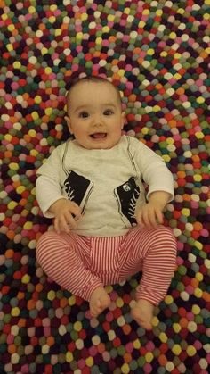 Little Miss Evie looking happy as can be in her Young and Moodie sneakers tee!