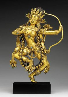 A Gilt Bronze Figure of Kurukulla   Tibet, 16th Century   The four-armed deity dancing with both legs angled, holding a bow and lotus in her left hands, wearing a garland of severed heads, a girdle of beaded festoons and pendent sashes inset with turquoise and semi-precious stones, her head slightly angled with the 'third eye', flanked by elaborate disk earrings and a skull tiara inset with hardstones and surmounted by flaming hair, richly gilt overall  12½ in. (31.7 cm.) high