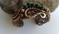 Handmade copper wire bracelet with natural green Jade  And again green stones:)I just can not resist them...For this bracelet I picked Dark green Jade and some copper beads.. They are wrapped in a recycled copper wire and together they are one beautiful story :))  width of the bracelet is 2 cm (25⁄32 inch)in the widest part of the bracelet is 3 cm (13⁄16 inch)  Measures of bracelet * Full circle is : 18cm or 7 3⁄32 inch     Bracelet is adjustable.  The copper has been aged and polished to…