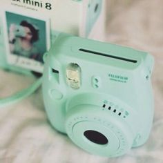 Cute blue version of a Fujifilm Polaroid camera Poloroid Camera, Instax Camera, Mini Camera, Instax Mini 8, Fujifilm Instax Mini, Wallpapers Verdes, Camara Fujifilm, Mint Green Aesthetic, Polaroid Pictures
