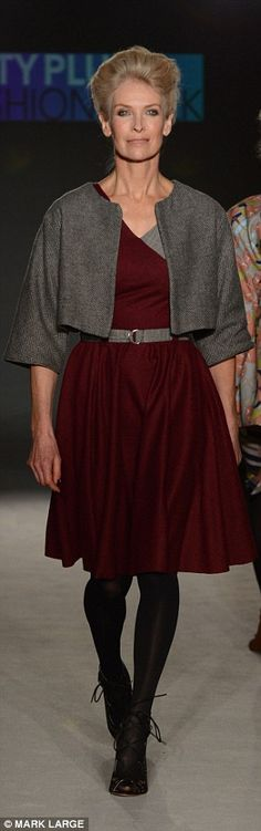 A grey and burgundy two piece dress and jacket combo looked both elegant and edgy...