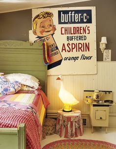 vintage poster, cute duck lamp, stove play set..very very cute &  quirky kids room.