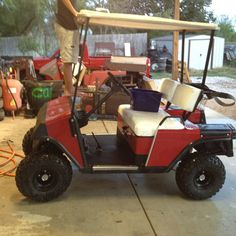 """E-Z-Go Marathon Electric. Came in for minor repair, ended up lifted. 4""""lift with 20x10-8 tires on 8"""" black steel wheels, chrome center caps and chrome lug nuts.   This is a low budget setup with a really great look.  Proof that you don't have to spend a fortune to have a good looking golf cart."""