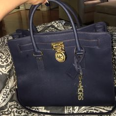 Michael Kores Tote Large MK Hamiliton in the navy Saffiano leather. Gold hard wear. Both body and inside are in great condition. Matching wallet is listed separately. Can bundle of interested. MICHAEL Michael Kors Bags Shoulder Bags